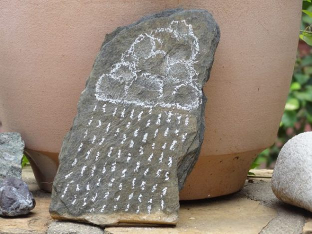20cm high flat stone, sepcially collected for this purpose from the Namib. I made the drawing with white Chalk drawing.