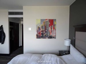 Hotel room and digital canvas print as found