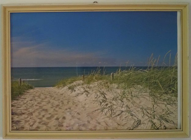 Cheap calendar print of beach scene in our holiday appartment