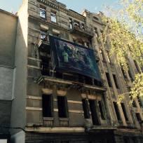 Vladyslav Krasnoshchok: old photographs being reworked and printed on large canvases, displayed on old buildings.