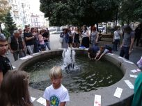 Vitaliy Kokhan's performance, releasing fish which can usually only be afforded by the rich into the public pond.