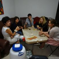 Gallery staff enjoying a pizza after a successful opeing.