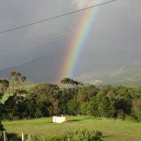 The rain always came, perfectly timed, when we were on the road again... here is the photo prove with a rainbow.